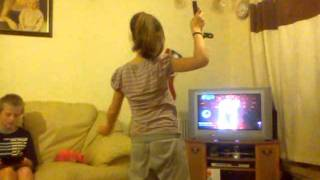 Lili trying to do the belly dance on the wii